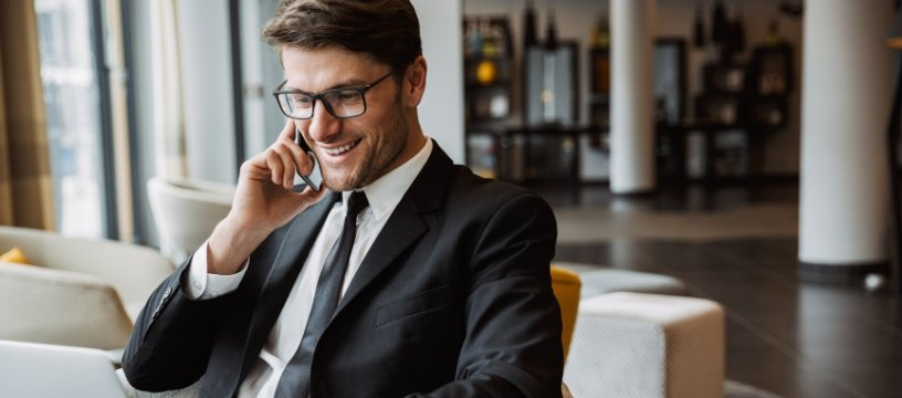 Caucasian business man in suit on phone