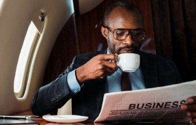travelling african american business man reading paper