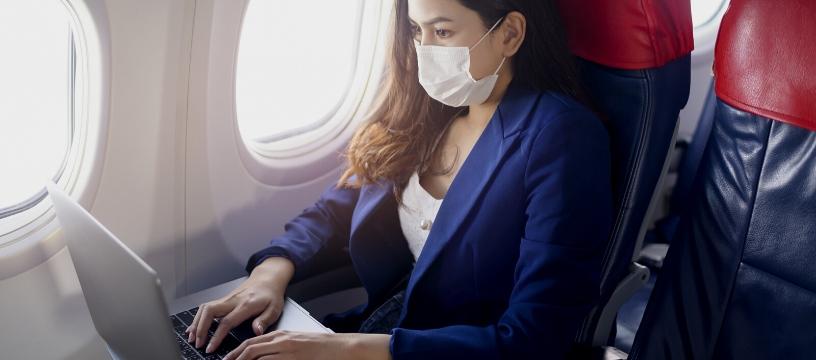 Asian female business traveller on plane