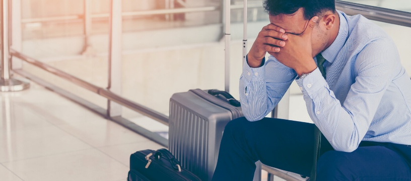 Caucasian Business Traveller with Anxiety in Airport