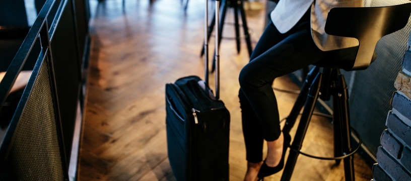 Caucasian Female Business Traveller in airport lounge