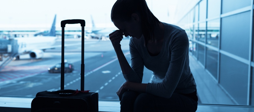 Caucasian Woman with Anxiety Symptoms at Airport