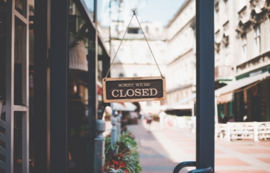 Closed sign on store during COVID