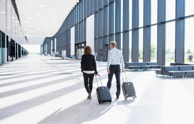 Female and male business travellers at airport