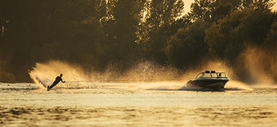 Female water skiing being boat